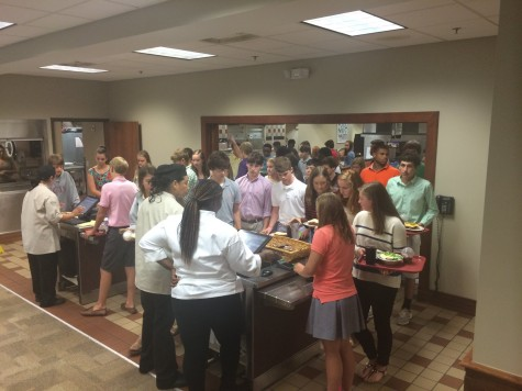 Students line up to enter their pin numbers in order to purchase their meals. The new checkout system led to slow lines at the start of the year.