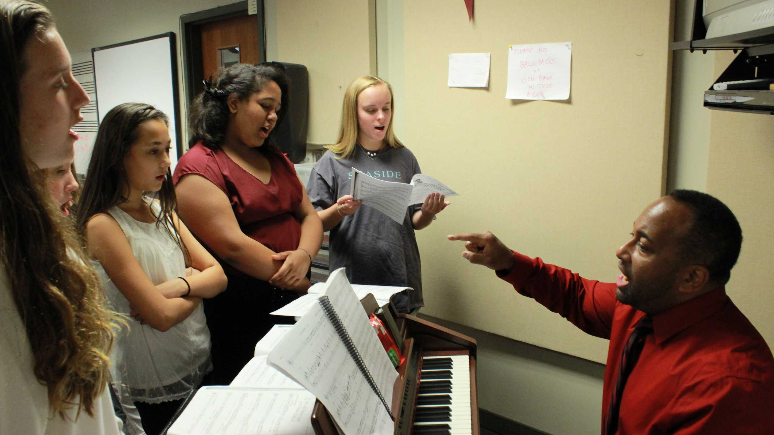 Students showcase their singing voices with Dennis Whitehead for the first part of their audition. All auditionees sang together to test their harmonies, and some were asked to do solos for further evaluation.