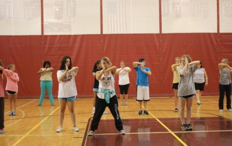 Students in the dancing class learn new hip-hop moves.