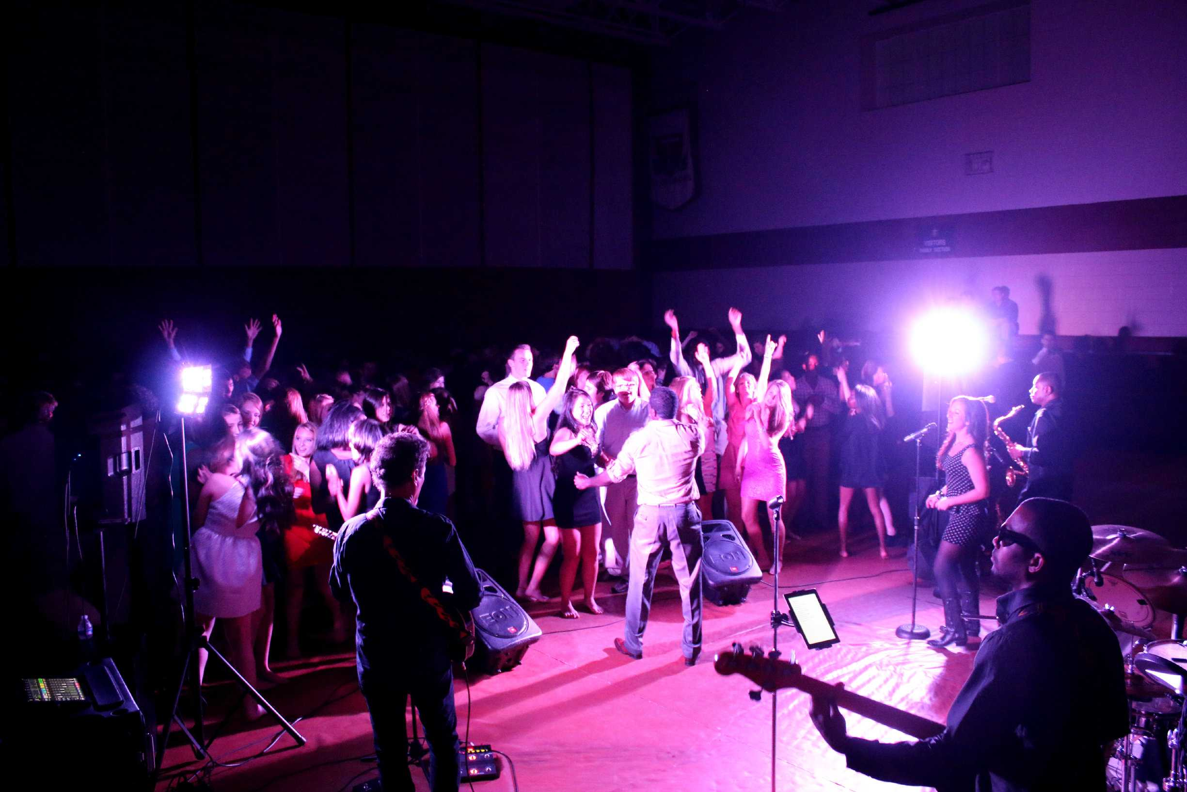 Students sing and dance along with Party Planet during the homecoming dance. Throughout the night, the band played songs varying from swing music to today's pop.