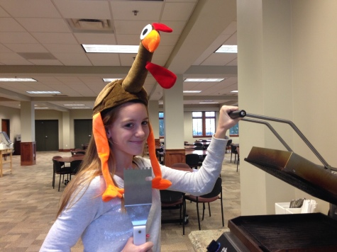 Senior Caroline Cannon admires the Panini press as she waits to begin her Thanksgiving feast. Cannon wished everyone a Happy Thanksgiving.