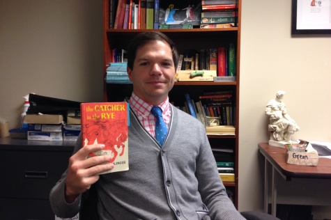 Mr. Roszel holds up one of his favorite books. His top five favorite books included