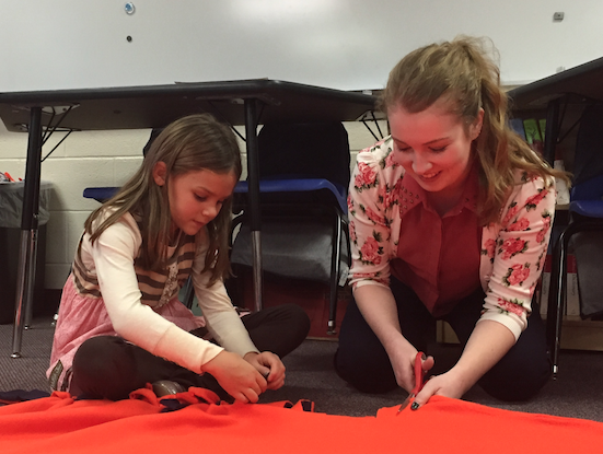 Allie Buckmaster and McClain Jones worked on a blanket for Fleece of Faith at the Germantown campus. The blankets will be donated to the local shelters.