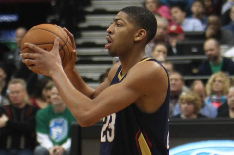 Anthony Davis searches for an open teammate during a game. The New Orleans Pelicans drafted Davis as the first overall pick in the 2012 NBA Draft.