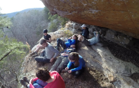 The students on the Ozarks trip enjoy spending time in the cliff-side cave before dinner time.