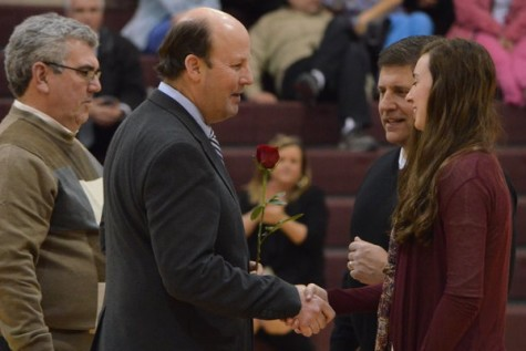 Mr. Taylor shakes hands with senior Lexie Marotta at senior night. This was Mr. Taylor's final year at St. George's.