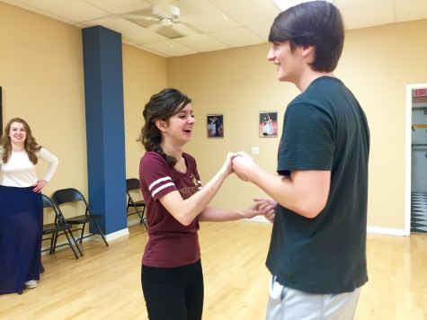 """Connor Funck '16 and Annie Vento '17 prepare to swing dance at Blue Suede Ballroom. At the practice, the instructor, Jonathan, taught the """"neutral stance,"""" how to turn and how to swing your partner or be swung."""