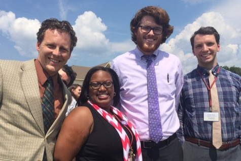 New teachers (from left to right) Mr. Jason Hills, Ms. Jessica Hardy, Mr. Sam Abrams and Mr. Jordan Wells pose for a picture in front of the school during the first fire drill of the school year. These four teachers came to St. George's from different schools and different states.