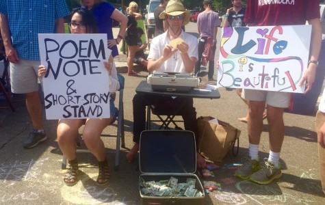 Artists and writers advertise an opportunity to receive a poem or short story on the spot. This year's annual Cooper Young Festival was held on Saturday, Sept. 19.