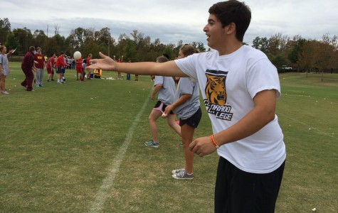 Sophomore David Quesada tosses an egg to his partner. One of the field days events was an egg toss.