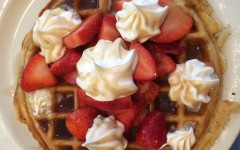 Laura McDowell orders a waffle with strawberries and whipped cream. There were waffles of every style on the menu.