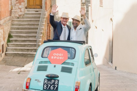 """Mr. Dennis Darling and his husband, Mr. Bryan Darling, pose the morning of their wedding in a car with a sign that reads """"Just Married"""" in Italian. Their wedding was held last summer in Italy."""