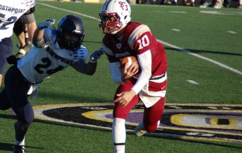 Junior quarterback Ben Glass avoids a defender. The Gryphons earned the state title last week.