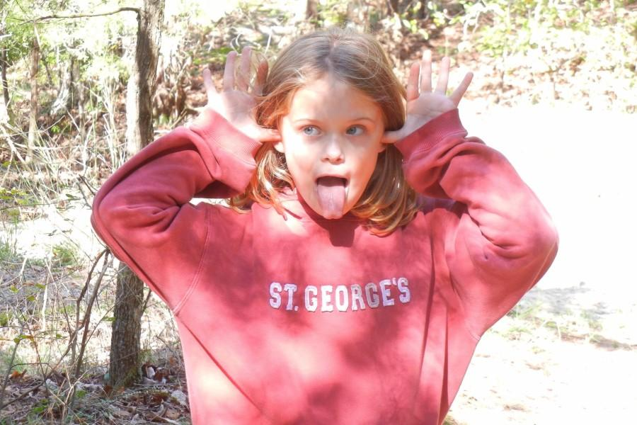 Carson Elizabeth Head strikes a silly pose during a walk in the woods. Through fundraisers led by the St. Jude's club and St. George's, over $160,000 has been raised for St. Jude's in remembrance of Head.