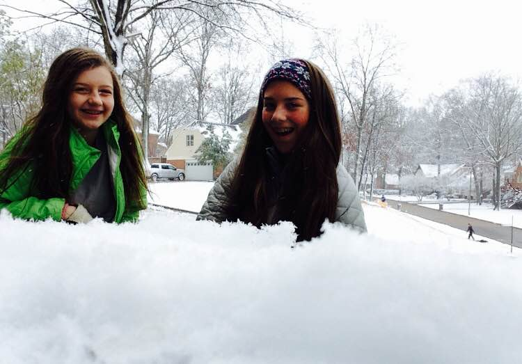 Eighth-graders Bess White and McKinley Farese play in the snow. Memphis had its first snow day on Friday, Jan. 22, and St. Georges did not have school.