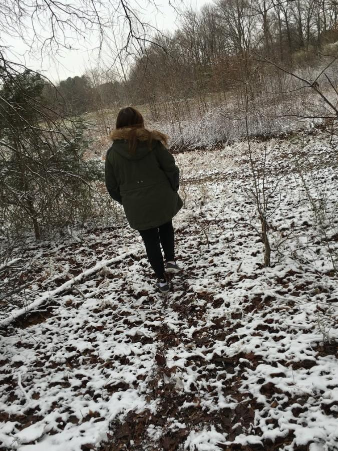 Eighth-grader Maggie Emmendorfer walks outside in the snow. Memphis had its first snow day on Friday, Jan. 22, and St. George's did not have school.