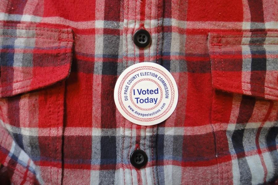 An I Voted Today sticker is proudly worn. Some people, like the person in this photograph, have chosen to wear red and blue on election days to represent the two political parties.