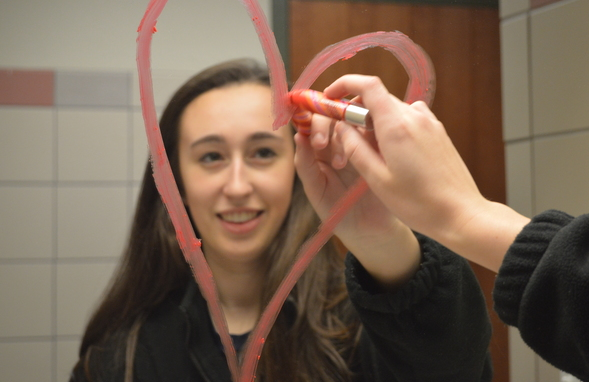 Sophomore Annie Murff displays her self-confidence by drawing a heart on the mirror in the bathroom. Murff plans to spend her valentines day with her friends and family.