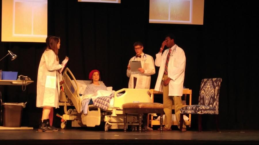 Sophomore+Margo+Valadie+and+seniors+Ellie+Babb%2C+Noah+Woods+and+Teddrick+Boyd+perform+a+scene+during+one+of+their+final+dress+rehearsals.+The+four+individuals+played+a+hospital+technician%2C+Dr.+Vivian+Bearing%2C+Dr.+Jason+Posner+and+Dr.+Harvey+Kelekian%2C+respectively.+