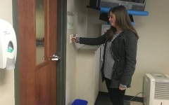 Sophomore Caroline Zummach turns off the light switch to conserve energy. In the first week of the competition, St. George's reduced their carbon emission by 26,000 pounds.