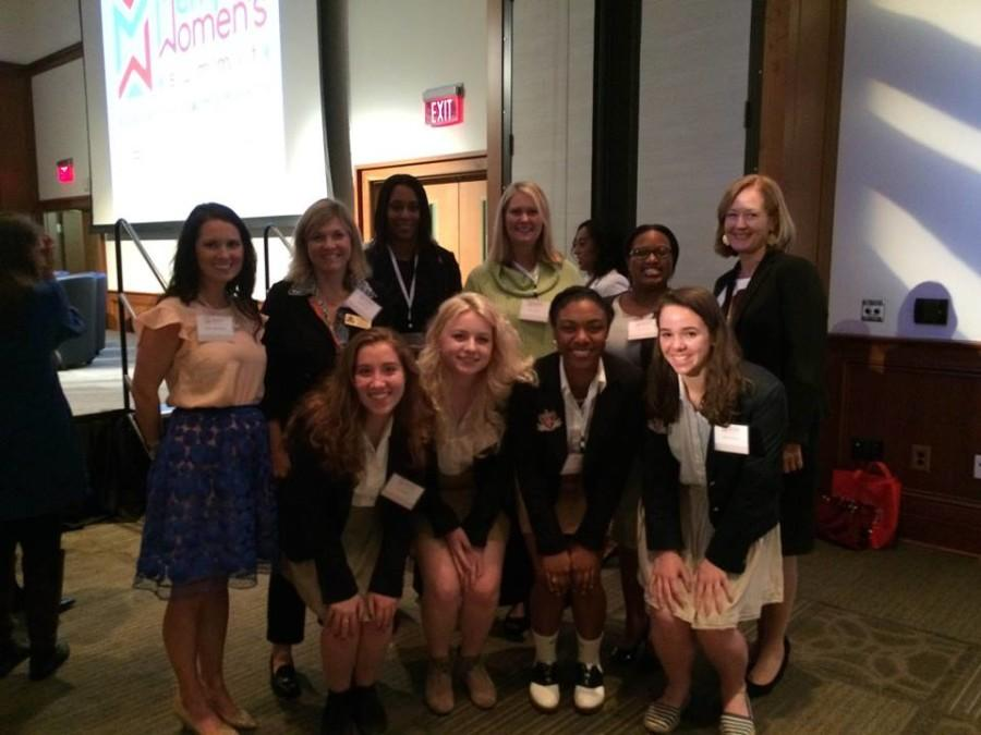 Juniors Katie Boyle, Chloe Booth, Essence Davis and Miriam Brown pose with members of the Board of Trustees at the Memphis Womens Summit. The Summit was put on by the Junior League of Memphis.