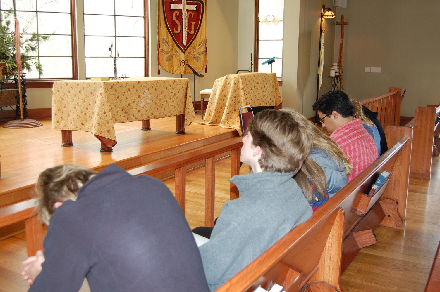 A student looks straight ahead while his peers pray in the Agape Chapel. Alternative chapels were introduced to the St. George's Upper School in 2006 and have evolved significantly since then.