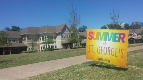 A sign for the Summer at St. George's program stands on the lawn of the Collierville Campus. the sign was advertising the new summer programs.