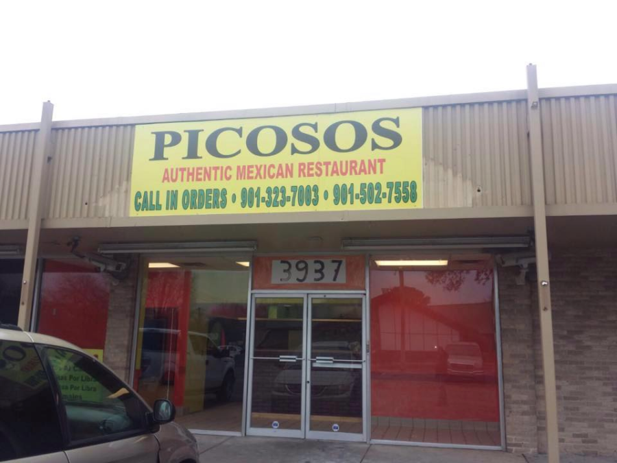 The+Los+Picosos%27+sign+hangs+above+the+door+of+their+new+location.+Los+Piscosos+serves+incredible+food%2C+including+chicken+torta%2C+rice%2C+beans+and+queso.+