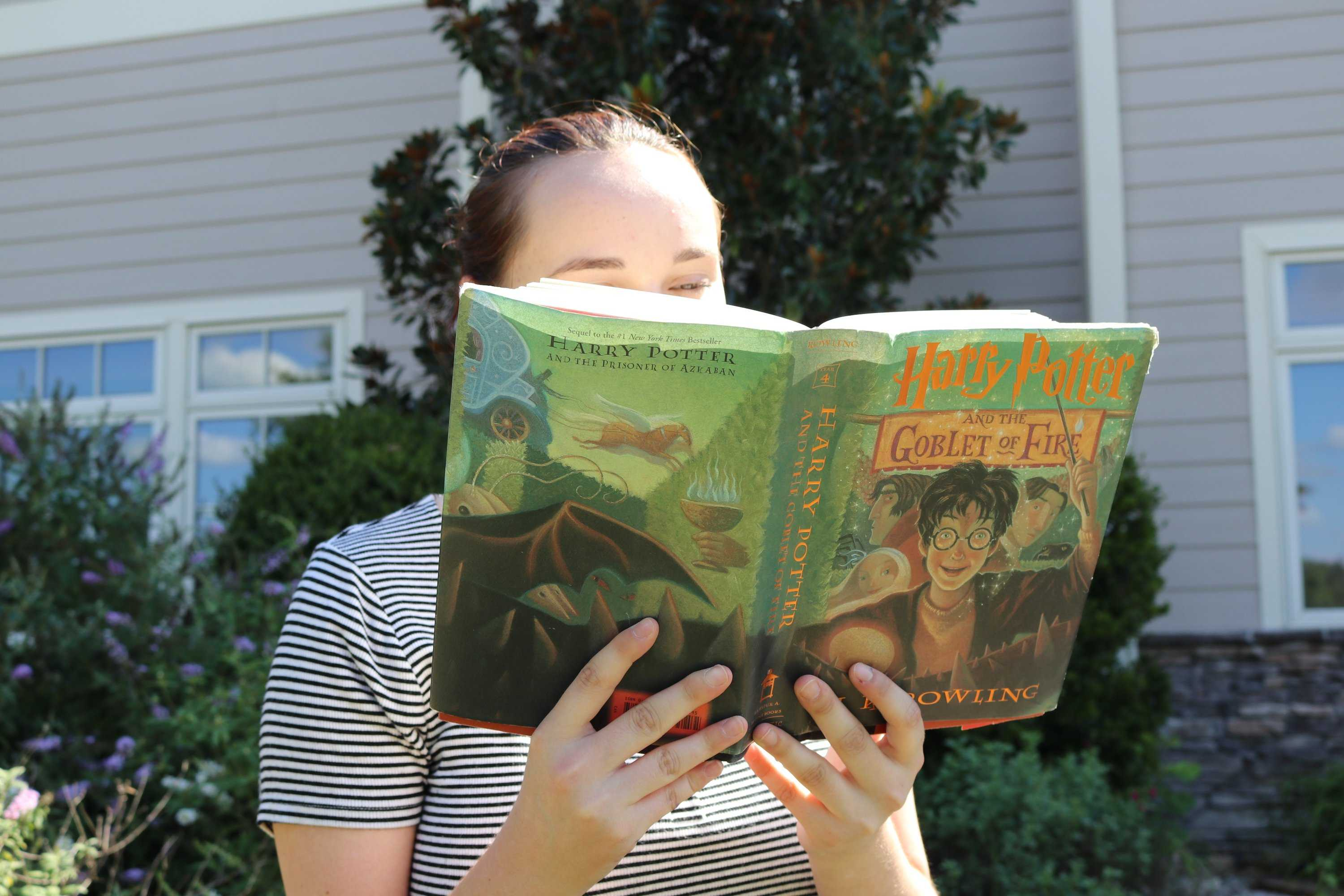 "Senior Laura McDowell reads ""Harry Potter and the Goblet of Fire."" McDowell read all eight Harry Potter books in a week."