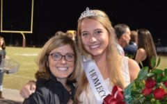 Homecoming Queen Avery Whitehead poses with her mother. Whitehead was crowned during halftime of the football game.