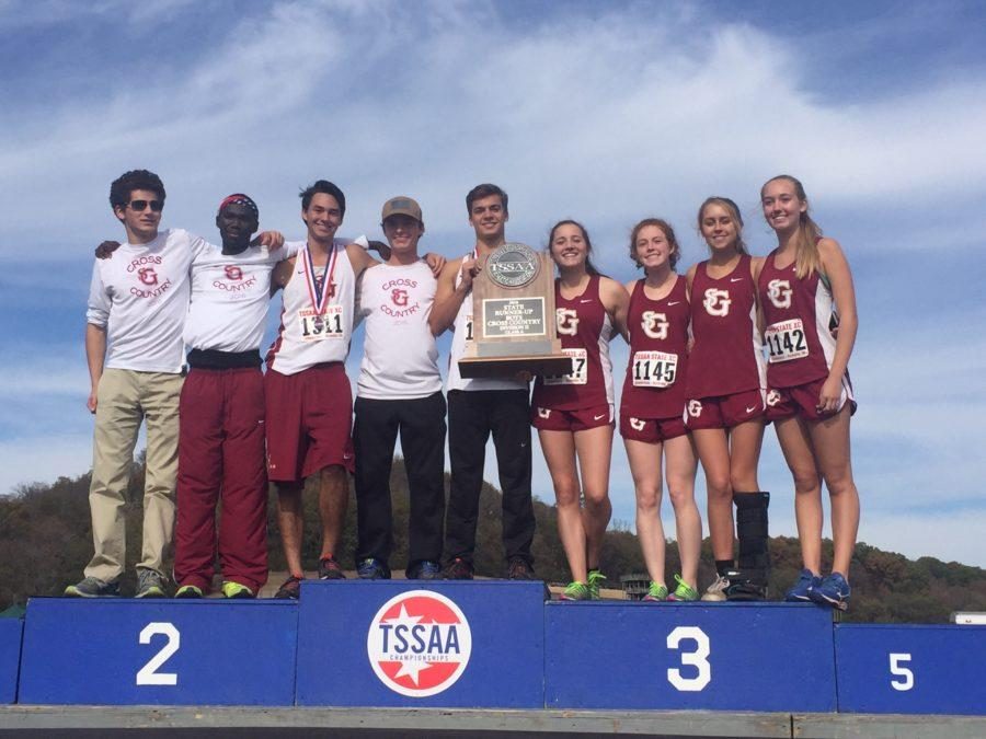 Nine+cross+country+seniors+pose+for+a+photo+with+the+trophy.+The+boys%27+team+was+the+Division+II+state+runner-up.