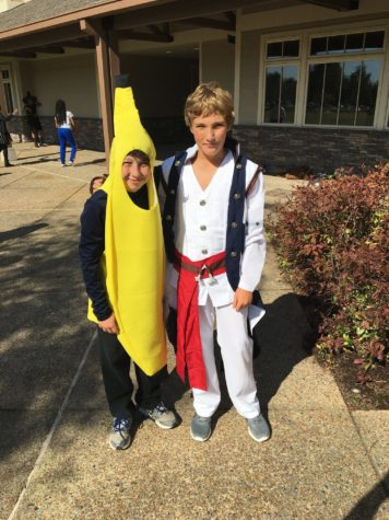 Seventh graders Will Wirth and Jack Newman pose for a photo during recess in their banana and pirate costumes. Students showed their Halloween spirit by wearing costumes to school on Oct. 31.