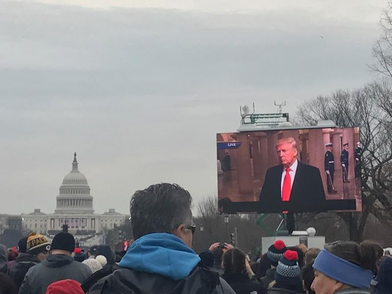 A+crowd+watches+president-elect+Trump+on+a+big+screen.+Donald+Trump+was+sworn+in+as+the+45th+president+of+the+United+States+this+past+Friday.