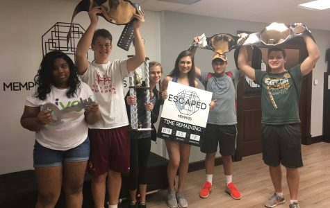 Juniors Ahjayla Bailey, Bennett Matson, Ellie Franklin, Natalie Yanok, David Graber and Hudson Beaudry pose with their awards after escaping at Memphis Escape Rooms. St. George's juniors explored the greater Memphis area on their class trip.