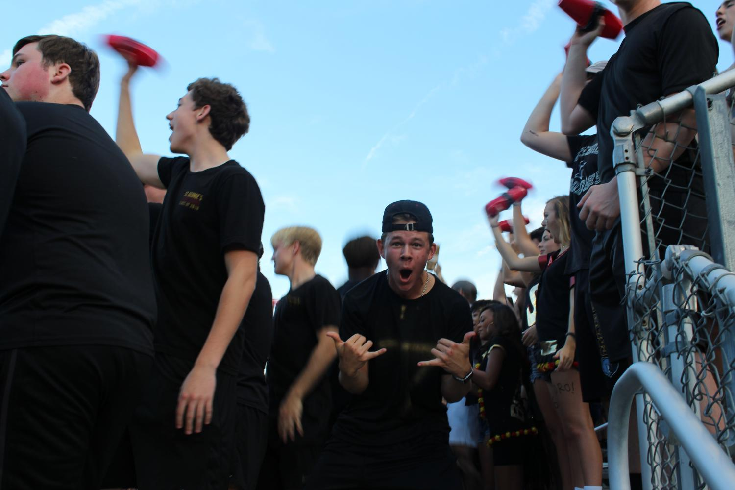Prefect of Spirit Dalton Reese celebrates after a touchdown for the Gryphons. The student section was lively and clothed head to toe in black on Friday for the first home game of the season.