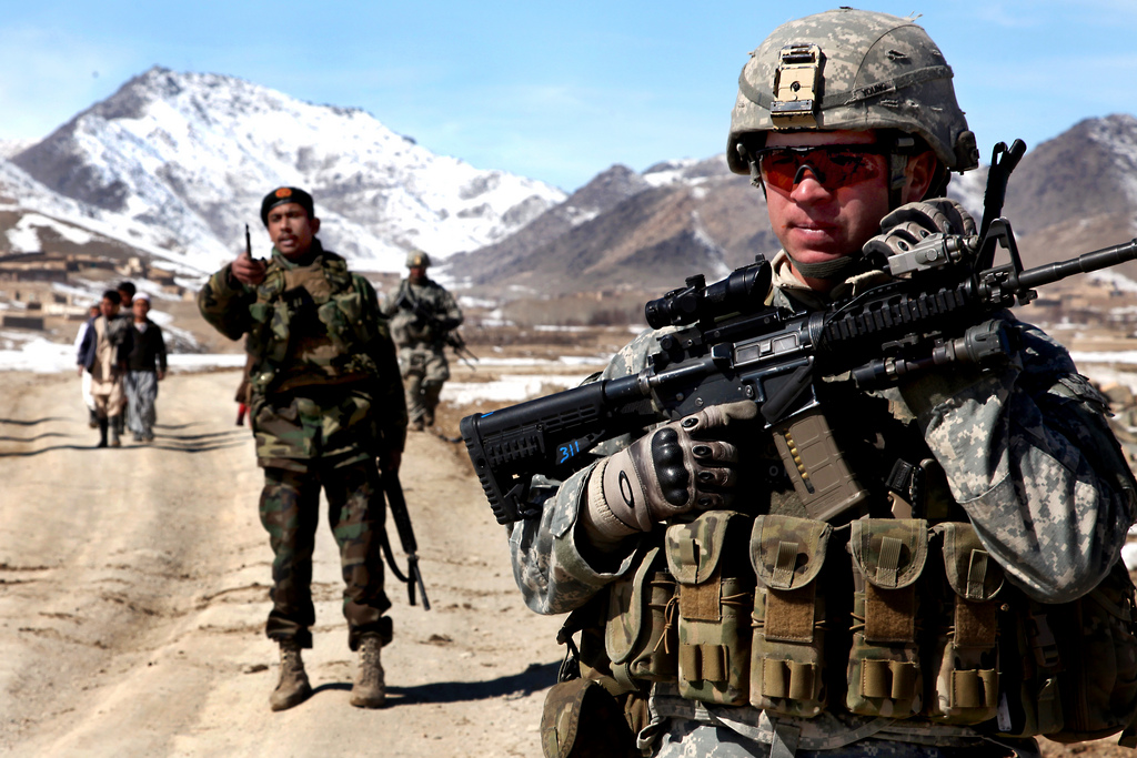 A U.S. Army Soldier from the A Company, 1-503rd Battalion, 173rd Airborne Brigade Combat Team, conducts a patrol with a platoon of Afghan national army soldiers to check on conditions in the village of Yawez, Wardak province, Afghanistan, Feb. 17, 2010. Partnership between the U.S. Army and the Afghan national army is proving to be a valuable tool in bringing security to the area.