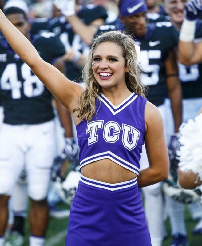 Alumna Elizabeth Evans cheers on the TCU football team from the sidelines. Evans, who cheered for the Gryphons, is now a cheerleader for the TCU Horned Frogs.