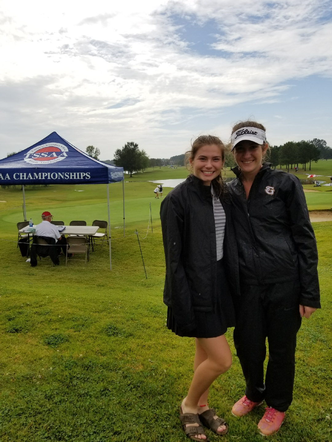 Junior Victoria England (right) stands next to teammate Grace Higley (left) at the girls' golf state championship. England has won the state championship twice.