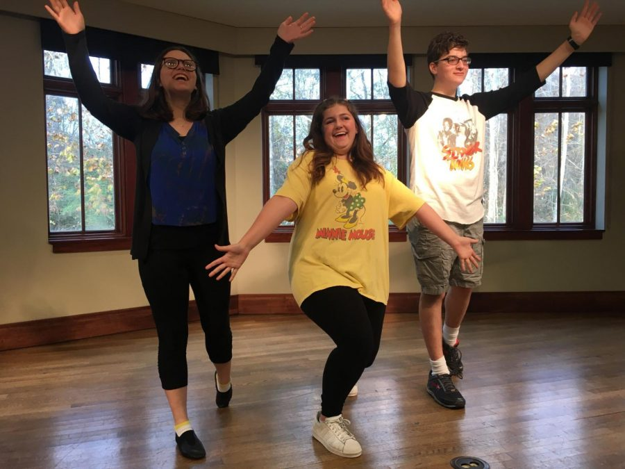 In this staged photo, Sophomore Maggie Emmendorfer, Junior Will Brown and Senior Emma Pounders learn to tap dance for the winter musical