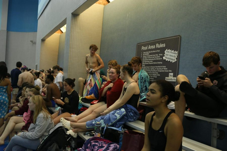 Gryphon swimmers watch their teammates compete before their own events. Some swimmers such as Junior William Irby had to a few hours before their first event.