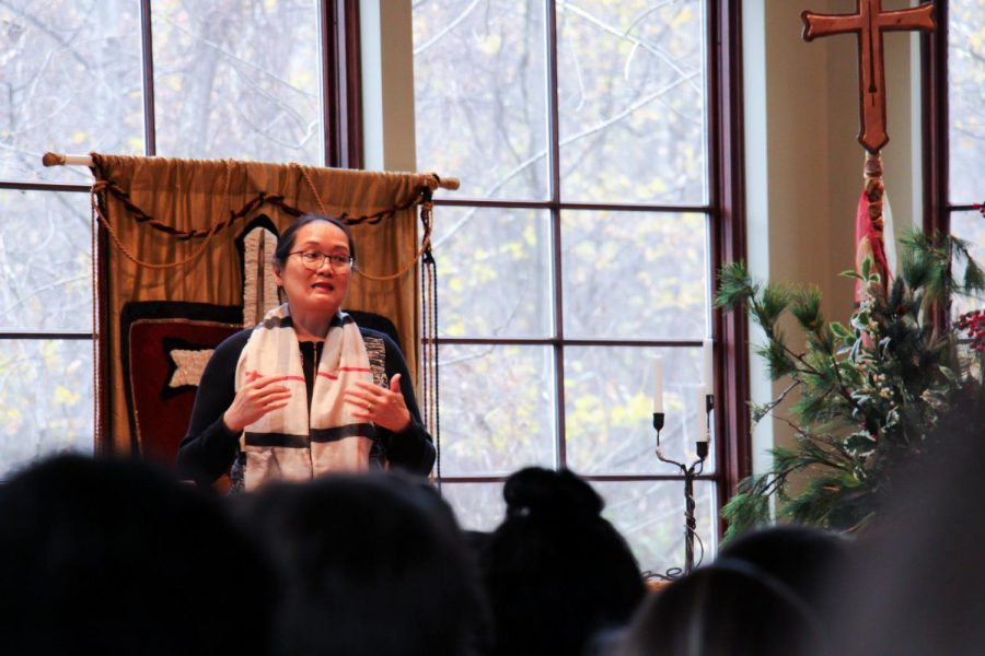 Dr. Jieyong Qian speaks to a group of students in the Agape chapel about her experience with re-education. At the age of sixteen, Dr. Qian was separated from her family and forced into labor with herders.