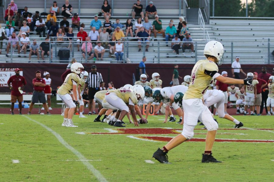 The Gryphons line up to run a play. The middle school football team played the Briarcrest Saints Thursday, Sept. 20.