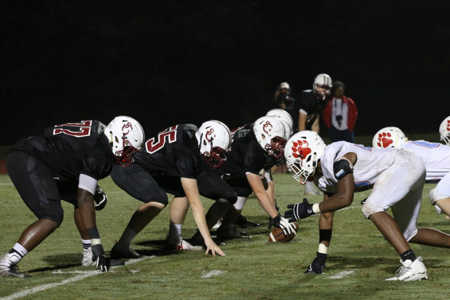 The gryphon offensive lines up for a final push in hopes of a touchdown against the University School of Jackson. The gryphons lost 28-7.