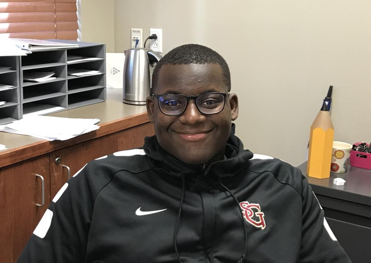Jacquavious Pryor smiles for the camera in his new glasses. If someone is ever looking for him, Mrs. Metz's room is a great place to start.