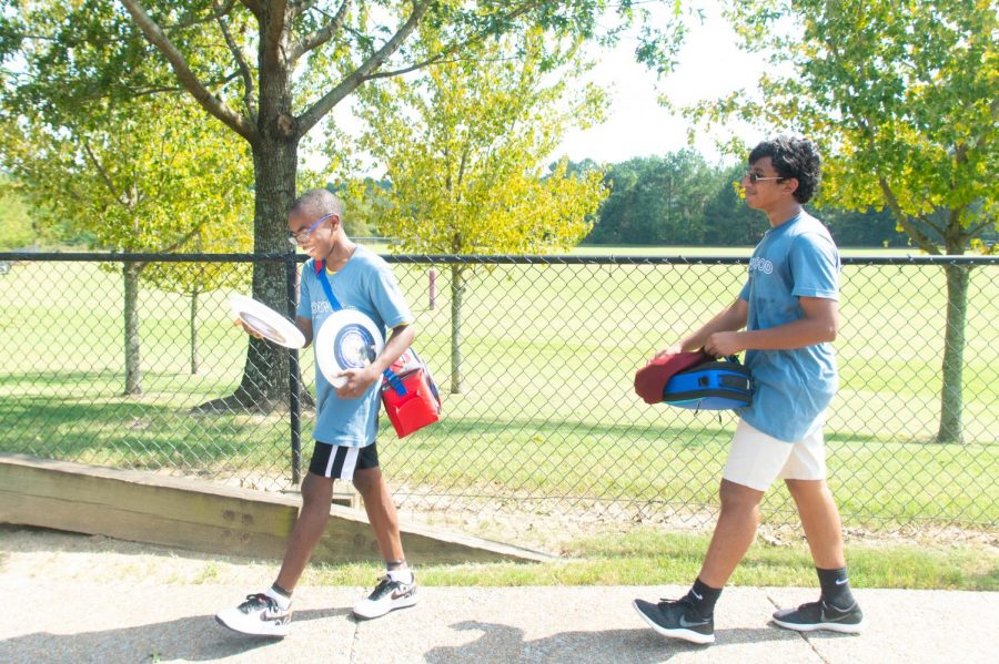 Freshmen Tories Dixon and Mehul Gupta walk back from a game of ultimate frisbee. They competed against other students to earn points for their house, Ironwood on Sept. 21, 2018.