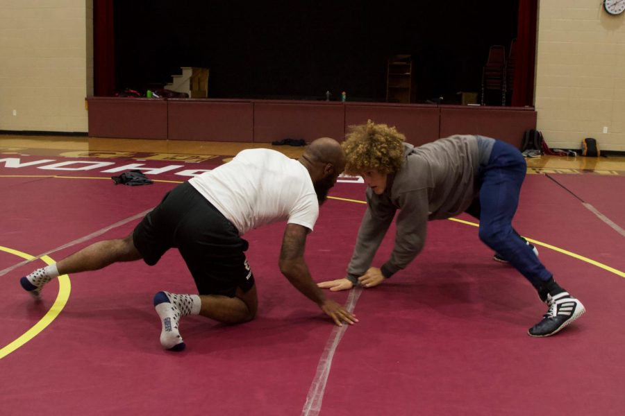 Coach+Eddie+Martin+and+senior+Jaylen+Spears+wrestle+during+a+practice.+This+is+Martin%E2%80%99s+first+year+coaching+at+St.+George%E2%80%99s.