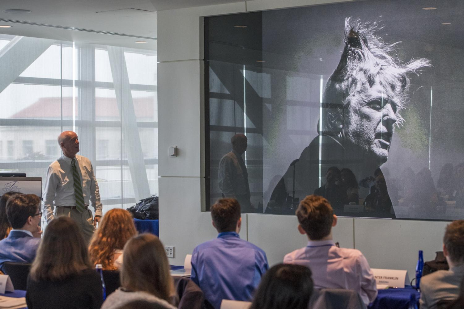 Photojournalist Doug Mills explains his photograph of President Trump to students attending the Free Spirit Conference in D.C. Mr. Mills was one of the speakers at the conference and discussed his relationship with presidents as a photographer.