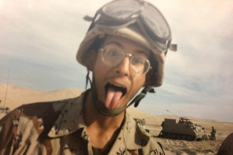 Mr. Smothers poses in the desert of Saudi Arabia, showing his joy even during Desert Storm. Waiting to be deployed into Iraq, Mr. Smothers had to make his own fun with his platoon.