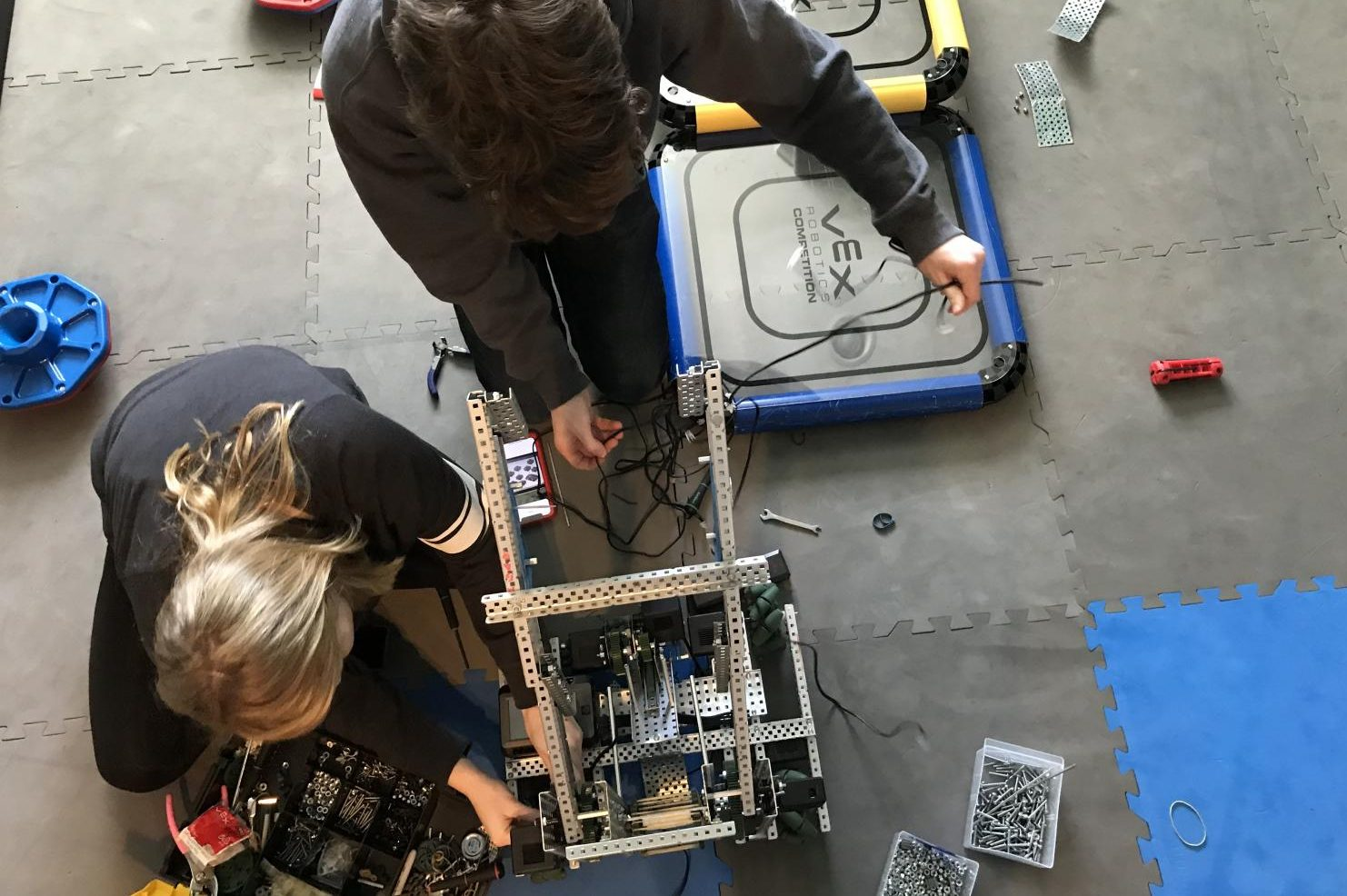 Junior Elizabeth Crane and Sophomore Kagan Sears prepare reconfigure their robot. They practiced on the field to prepare for the upcoming competition.