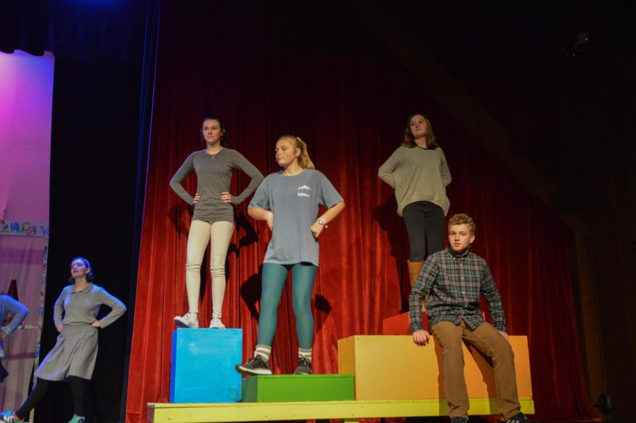"""From left to right: Hagen Brock, Madline Clark, Mary Alice Murphy, Mary Caroline Collier, and Nicolas Gutierrez practice their dance moves for the musical. The musical featured songs like """"Interplanet Janet"""" and """"Conjunction Function""""."""